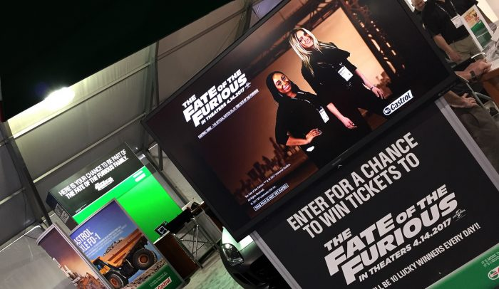 movie trading cards at Castrol's Fate of the Furious booth at ConExpo